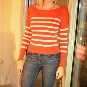 Striped orange and white sweater